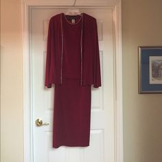 Crimson Colored Alex Evening Dress with Jacket Worn one time. Beautiful crimson colored 2 piece set. Tank dress with rhinestones around collar. Jacket with full length sleeves and rhinestones down each side of front. No noticeable signs of wear. Perfect for the holiday season! Alex Evening Dresses Maxi