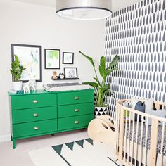 Neutral colored boys nursery with a bright pop of kelly green