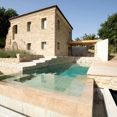 If only this was my holiday home. Beautiful minimal pool and traditional stone house Pool Water Features, Beautiful Pools, Swimming Pool Designs, Stone Houses, Modern House Design, Villa Design, Design Hotel, Modern Houses, Exterior Design