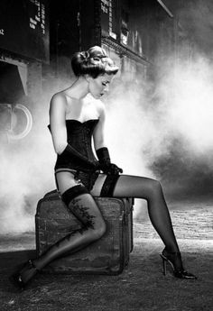 sexy black and white steamy photo of women waiting at train in stockings and lingerie.