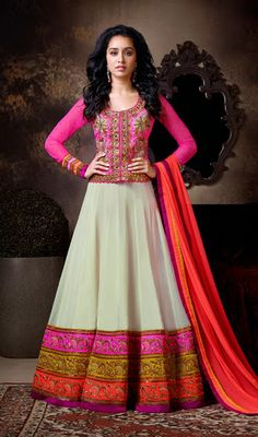 Shraddha Kapoor Cream Georgette Floor Length Anarkali Suit Cast tender enchantment like Shraddha Kapoor dressed in this cream faux georgette floor length Anarkali suit. Pita work, beads, embroidered and stick on crystals enhanced foliage patterns on the contrasting yoke and hemline patches summate radiance to the attire. #OnlineShoppingAnarkaliSuits #AnarkaliSalwarKameez