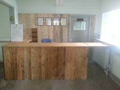 Beautiful Counter With Pallet & Cladded Wall Backdrop  #kitchen #palletbar #palletcounter #recyclingwoodpallets Use of both softwood and ply pallet lats to construct a counter with flap and shelving (not seen in photo) within our main entrance of our project bui...