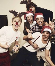 One Direction........ Christmas addition...... is it just me or wouldn't they make the cutest elves!!!