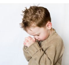 child praying...either by beside or at mealtime would be a beautiful memory to cherish