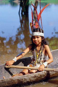 Befeathered Little Native South American Girl Rowing Canoe https://fbcdn-sphotos-f-a.akamaihd.net/hphotos-ak-ash3/551774_301496879938988_108970410_n.jpg