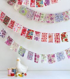 I like the idea of this non-triangular bunting.  Even a mix of different shapes might look cool...use up some fabric scraps!