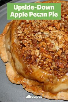 Love apple pie and pecan pie? Combine them by backing this upside-down apple pecan pie! This pie recipe incorporates pecans, Granny Smith apples, cinnamon, and nutmeg to bring together the tastes of apple and pecan pie in one delicious and easy fall dessert recipe. This homemade pie will be a hit at Thanksgiving or Christmas dinner!