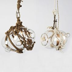 These are the coolest pendants.  They're from The Future Perfect where someone is hand blowing some beautiful, unique and eclectic lighting.  Too bad about the price though.  $2700.  I think my entire living room cost less than that.