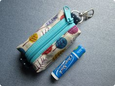 Keyring Zipper Pouch - Even though it's tiny, she does some cool ways to sew it that might apply to bigger bags too