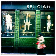 Fashion is a religion for so many people, although probably not the woman who happened to be walking past!