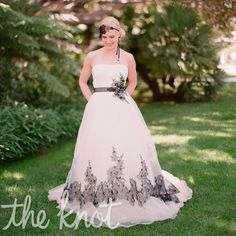 Gorgeous black and white wedding gown by Alfred Angelo. Tres chic!