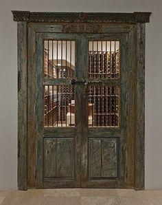 Love these doors to the wine cellar. Designer Marc Appleton.