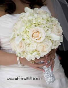 This bridal bouquet was adorned with beautiful crystals, hydrangeas, and roses.
