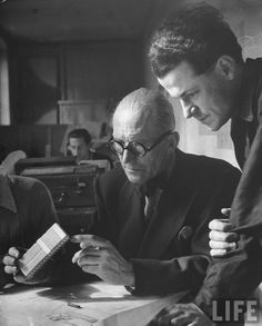 Le Corbusier and student working on project for French ministry of reconstruction-- Paris, France 1946.