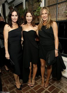 After-party: Jennifer Aniston (right) managed to avoid the fan frenzy surrounding her SAG ...