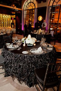 maybe black rosette fabric instead? Black and white wedding reception. Ruffled tablecloth, black chiavari chairs  www.wedinthecity.com