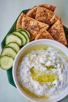 Tzatziki is a Greek yogurt (or sour cream) based sauce with cucumber, garlic, and fresh herbs. Here's how to make the best version of this versatile condiment at home. This recipe is easy and healthy and tastes so good with grilled meat, pita, veggies, or as a sandwich spread! A fresh and light healthy dip for parties too!