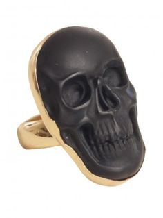 Gold tone cocktail ring featuring matte black Obsidian stone skull pendant and baked lacquer finish to protect metal from turning or tarnishing