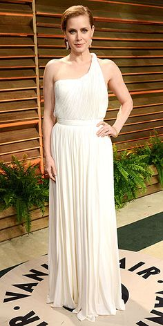 All the Afterparty Dresses, from Pretty to Plunging | AMY ADAMS | Another star who couldn't resist the chance to wear a fresh gown for the Vanity Fair afterparty. The nominee kept her sophisticated French twist, but changed into a one-shoulder Carolina Herrera dress and metallic danglers.