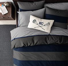 Bedding in bold stripes and standout colors. Inspired by iconic rugby shirts.
