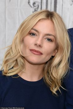 Flawless: Sienna styled her blonde tresses into loose waves falling from a centre parting - a stylish and subtle look