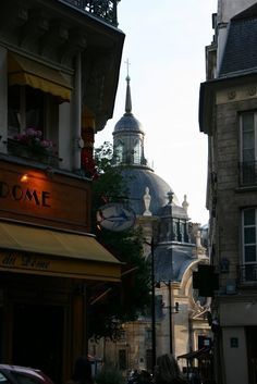 The dome of the Temple Sainte-Marie, in the Marais, can be seen in the background.