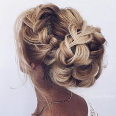 This pretty braided updo wedding hairstyle perfect for any wedding venue - Beautiful wedding hairstyle Get inspired by fabulous wedding hairstyles