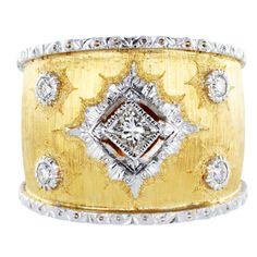 BUCCELLATI Gold DIamond Band,Two tone 18 karat yellow and white gold textured finish wide Estate band set with 4 round brilliant cut diamonds and 1 princess cut diamond.