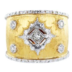 BUCCELLATI Gold DIamond Band,Two tone 18 karat yellow and white gold textured finish wide Estate band set with 4 round brilliant cut diamonds and 1 princess cut diamond.