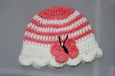 Girls Striped Cotton Crocheted Summer Sunhat Butterfly Hat. This striped hat is a delightfully sweet summer hat. A soft striped cloche style hat is embellished with a fluttering butterfly reminiscent of the first blush of spring. This crochet butterfly hat is perfect as a matching sisters set, baby photography prop, or as part of a girls spring outfit that needs just a touch more flair. If you would like a different color than is show please leave a note in the Notes to Seller section in...