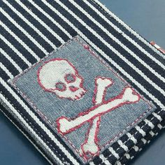 A little bleach painting on denim, some free-embroidered, a smattering of appliqué  and there it is, the pirate skull card wallet! Custom design for a lovely etsy customer.