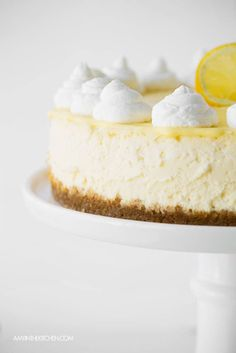 Lemon Cheesecake with Lemon Curd taste just like lemon icebox pie. It's so refreshing and yummy! AmyintheKitchen.com