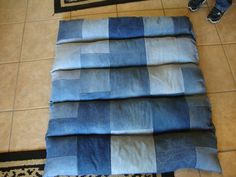 "Dog bed I made from recycled denim jeans and sewing/quilting scraps for stuffing. 37"" x 35"""