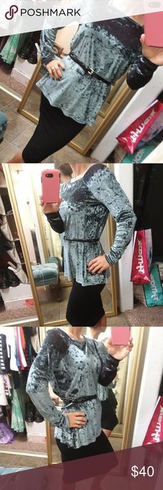 Long sleeve blouse This blouse is a silvery gray teal color that's very shimmery almost like a crushed velvet. At different angles you can slightly see maroon coming through for a color highlight. Very soft and Slinky but warm and cozy at the same time. This is a medium but it is loose fitting. Coccoli Tops Blouses