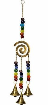 An beautiful polished brass spiral hangs from a chain adorned with beads symbolizing the colors of the chakras.    From the spiral hang three polished brass bells whose chains have also been adorned with chakra colored beads. This beautiful piece will add color and movement to any space.    Height: 12 in. Width: 2.75 in Materials: Glass beads & brass