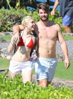 Pin for Later: Miley Cyrus and Patrick Schwarzenegger Show Skin and PDA in Hawaii