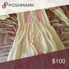Free People peasant dress NWOT Free People peasant dress - cream & pink. Bought the dress and wore it once, these colors just don't work on me :/ comes with original matching, cream colored slip to wear underneath. Size XS but fits loosely more like a M. Free People Dresses High Low