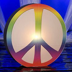 Our authentic anti-war symbol is illuminated to bring a bright retro look to your big night! OurGiant Lighted Peace Sign has tie dye look and is printed on clear corex.