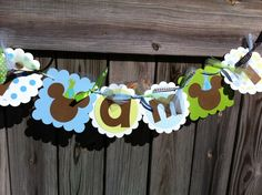 I AM 1  banner in Light Blue, Lime Green, with Brown Mickey Mouse Characters