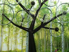 I LOVE this bicycle wheel tree. The wheels spin in the wind. It is meant to be a bicycle stand for parks.but a fun sculpture anywhere! Bicycle Wheel, Bicycle Stand, Bicycle Spokes, Bicycle Parts, Garden Crafts, Garden Art, Garden Ideas, Recycled Bike Parts, Wind Sculptures