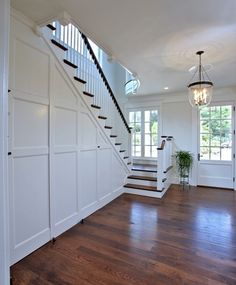 Hidden powder-room and closet Stair Railing, Stairs, Hidden Toilet, Empty Room, East Hampton, Batten, Panel Doors, Hallways, Powder Room