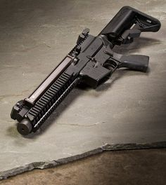AR 57 - it is a one piece 5.7×28mm upper that attaches to a AR-15 lower and uses the 50 round FN P90 magazines.