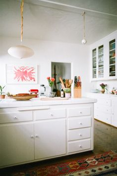 Cabinets painted in Cloud White by Benjamin Moore. Lauren Soloff Kitchen in Los Angeles | Remodelista