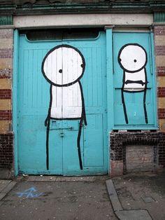 stick people on blue door. street art
