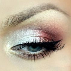This gorgeous eye makeup uses eye shadow in metallic white, pink, and brown shades. Winged tip liner and lush lashes complete the look. Try this night out look today.