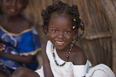 Africa | Young girl photographed in Senegal by  Walter Luttenberger