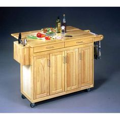 I just think this Wood Top Kitchen Cabinets/Cart is such a great idea.  As a portable Breakfast/Salad Bar, this would be so convenient for entertaining guests or for Family Gatherings. -- Julianna