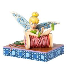 Disney Traditions falling fairy Tinker Bell figurine by Enesco. From Disney Traditions gift collection designed by Jim Shore. Features Tinker Bell tumbled over a spool of thread. Disney Figurines, Fairy Figurines, Collectible Figurines, Disney Statues, Disney Movies, Disney Pixar, Walt Disney, Disney Characters, Disney Stuff