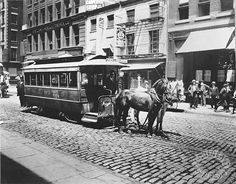 Gilded Age New York City, Horse drawn trolley car, on cobblestone Bleecker Street, and Broadway. c.1900