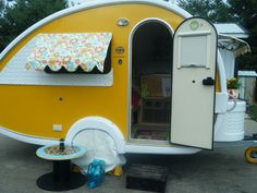 Daisy's new window awning (adorable awnings on this TAB...and cute spool table!)